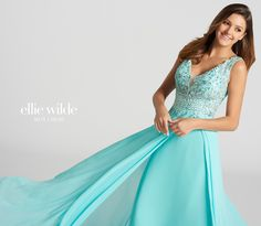 Ellie Wilde EW118150 - Sleeveless chiffon and lace slim A-line dress featuring plunging V-neckline with tonal illusion panel and scoop back. Bodice is made of tonal illusion fabric covered in lace and stones and coverage is provided by tonal bust cups. Lace and stones overlays the top of chiffon skirt which billows out over the hips into a full skirt. Skirt is made of two layers with the top one splitting at the left hip to reveal the underskirt.