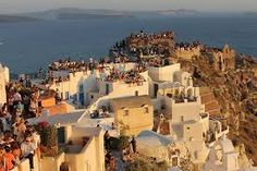 Hundreds of tourists that have gathered to see the Oia sunset, Santorini island, Greece - selected by oiamansion.com