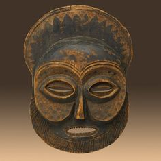 MBUNDU MASK, ANGOLA Carved wood with incised linear and geometric design, classic coffee bean eyes, and well-defined cheeks, early to mid-20th c. Such masks are worn during the initiation of young men into adulthood. | TRIP DOWN MEMORY LANE: MBUNDU (AMBUNDU) PEOPLE: ANGOLA`S MATRIARCHAL TRIBE THAT RULED THE KINGDOM OF NDONGO AND MATAMBA IN THE ANCIENT KINGDOM OF KONGO