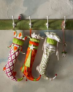 Bead-Bedecked Christmas Stockings by Patience Brewster at Horchow.  Cute stocking hanger!!