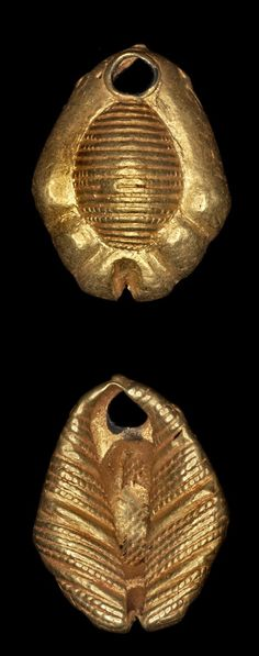 Africa | Hollow lost wax casting in gold of a bead in the shape of a cowrie shell (sedee) | Asante people. Royal Palace, Kumase, Ghana | 19th century (prior to 1874) || {3.62}