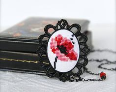 Hand-embroidered Poppy necklace in black vintage frame - Black and red - Flower jewelry - Cross stitch necklace