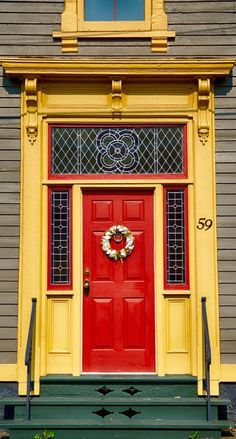 Vibrant Yellow Gold and Red Door and Entrance in Lunenburg, Nova Scotia, Canada