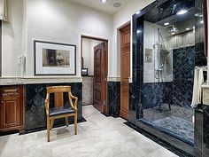 Midnight blue or jet black? Arresting duo chromatic marble keeps you guessing at 3148 Above Stratford Pl, Austin Property Listing: MLS® #3840057 #marble #austinrealestate #morelandproperties #bath