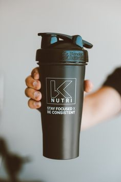 """Shaker Bottles are perfect for mixing your BCAAs, favorite protein shake, or even as a sturdy water bottle. Featuring the K Nutri logo and our motto """"Stay Focused x Be Consistent"""" Protein Shaker Bottle, Wire Whisk, Blender Bottle, Workout Essentials, Nutrition Shakes, Stay Focused, Protein Shakes, Motto, Drinking"""