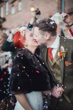 Beautiful red-haired bride wearing a Justin Alexander Gown Confetti shot  http://lifelinephotography.co.uk/