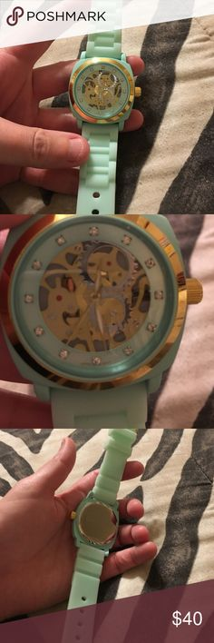 Anthropologie viscid mint green watch exposed gear Mint green watch by viscid from Anthropologie, only worn a few times, great condition, non smoking home, band is rubber Like material, exposed gears, really neat, paid over $50, will need new battery Anthropologie Accessories Watches