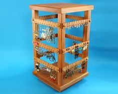 Earring Holder - Jewelry Organizer - Store Display, Cherry, Wooden, Jewelry Holder, 4 Sided, Spinning with Revolving Base. Holds 120 pairs. $97.00, via Etsy.