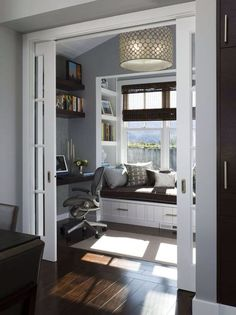 Contemporary Home Office with Window shade, Beadboard ceiling, Smart furniture chunky floating wall shelf, Built-in bookshelf