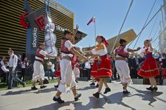 "Slovak folk dancers perform and President Andrej Kiska tries out a VR headset during ""Slovak Day"" at the international Expo Milano 2015. Photo: TASR Related story: http://en.rsi.rtvs.sk/articles/news/83288/president-andrej-kiska-opens-slovak-exhibition-at-expo-milano-2015"