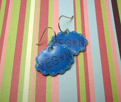 For Vegans and Vegetarians alike, these VEG*N earrings let YOU fill in the blank! These cloud-shaped earrings, glazed with a lovely sky blue, bring lots of attention to the face while also allowing you to show your pride.