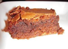 Amaretto Brownies Or the easy way is to use a box Brownie mix and pour Amaretto over the top while it is still warm.