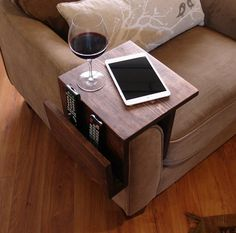 what a wonderful idea.  this piece is just 70$.  good stuff -- Simply Awesome Couch Sofa Arm Rest Wrap Tray Table by KeoDecor