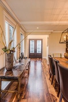 """Benjamin Moore Elephant Tusk--""""Reclaimed Walnut floors, Benjamin Moore elephant tusk on walls, hand forged iron chandelier, Live edge table, leather studded dining chairs."""""""