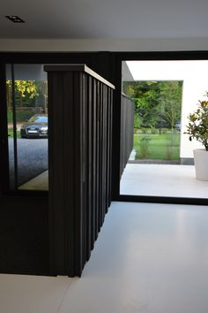 binnen gebruik houten gevelbekleding ontwerp Christophe Baetens