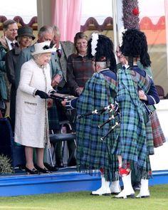 Queen Elizabeth II makes presentations during the Braemar Highland Games 2014 in Scotland.