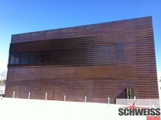 Two schweiss one-piece hydraulic aluminum doors were installed on the Louisiana Hall of Fame. The louvered doors were clad in copper and when closed they are barely visible to the naked eye. (Photo courtesy of Avallone Architectural Specialties) Natchitoches Louisiana, Metal Facade, Library Inspiration, Sport Hall, Aluminium Doors, Copper Wall, Wall Cladding, Sounds Good, Architecture