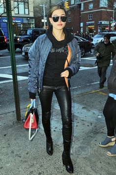 Hailey Baldwin wearing Vetements Oversized Logo Hoodie, Givenchy Prive Stretch Nappa Leather Boots, Saint Laurent Small Rive Gauche Colorblock Satchel