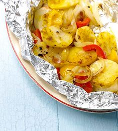 Sweet peppers, onion, and potatoes are seasoned, wrapped in foil, and grilled in this easy side-dish recipe.