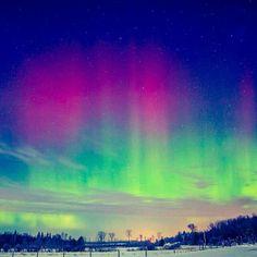Vibrant auroras dance across the nighttime sky in the Upper Peninsula.