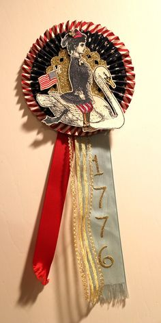 """Vintage style """"cockade"""" (award) made by Laura Turner using Character Constructions stamps."""