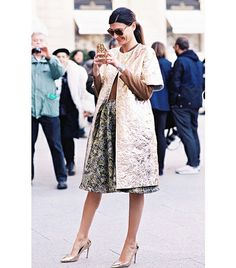 During Fashion Month, Battaglia threw a short-sleeved crinkled coat over a jacquard skirt and gold Gianvito Rossi Pumps ($578). The textured topper and full jacquard skirt keep the look regal, rather than garish.