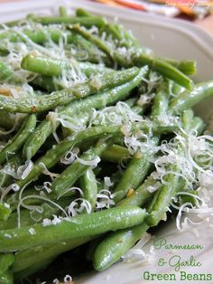 These simple Parmesan & Garlic Green Beans take only minutes to make and go well with fish, chicken or beef for dinner! CozyCountryLiving.com