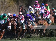 Runners and riders jump Canal Turn on the first time of asking during the 2018 Randox Health Grand National at Aintree Racecourse on April 2018 in Liverpool, England. Liverpool England, Grand National, April 14, Horse Racing, Runners, Stock Photos, Health, Pictures, Image