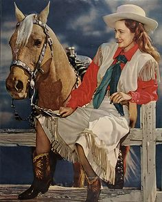 Fringed western outfit; split skirt and vest with shirt and cowboy boots. #vintage #cowgirls #fashion