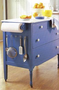 love the idea of putting a dresser in the kitchen.