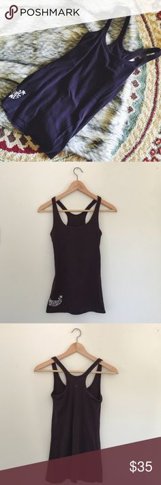EXCLUSIVE lululemon Tank This is an exclusive Haleiwa Bowls lululemon razorback tank! I used to work at Haleiwa Bowls and they were specially made for us. I no longer wear it so am passing it along! Excellent condition. Beautiful açaí purple color. lululemon athletica Tops Tank Tops