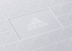 """London-based studio Colt was commissioned by Adidas to create premium packaging solutions for the arrival of Adidas Athletics.  """"The Z.N.E (zero negative energy) hoodie which lead the launch, is designed to block out any distractions and create a zone around the athlete in which they can focus. By using pyramid foam panels more commonly associated with sound-proofing as an external element, Colt were able to create a unique solution previously unseen in the market.  This theme was continued…"""