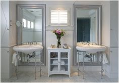 Love the mirrors installed length-wise behind the sinks.