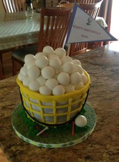 Bucket of Balls - Bucket of Golf balls.. cake is 4 layers carved 9in down to 7in. Golf ball are white chocolate. TFL