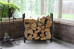 It's the perfect time of year for cozy evenings by the fireplace. This indoor/outdoor firewood rack is a practical, yet thoughtful gift for someone who loves using their fireplace or firepit to start and enjoy real, wood-burning fires. #GiftGuide
