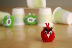 Angry Bird Pom poms - I need to make a few of these and stick them in MOAO's briefcase and pockets!