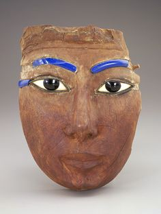 Face from a coffin ca. 1539-1190 BC, New Kingdom, Wood (sycamore fig) and glass.