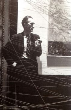 Duchamp at the installation of 'First Papers of Surrealism' (1942) (photo by Arnold Newman)