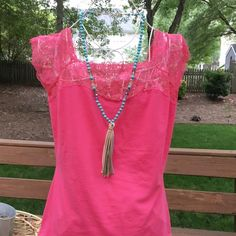 Fuchsia plus size top with lace! This adorable top features a lace yoke- cap sleeves and a square neckline! Tops