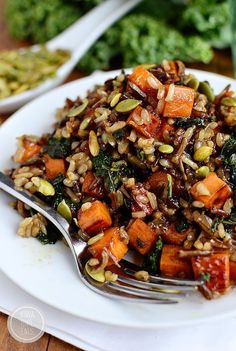 "Caramelized Sweet Potato and Kale Fried Wild Rice is a flavor-packed side dish that is anything but forgettable! To Veganize use veggie stock and vegan ""butter."""