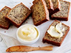 Adding sour cream to the batter brings a rich and creamy tang, while scattering chopped pecans brings on a satisfying crunch in Momma Callie's Banana Nut Bread with Honey Butter.