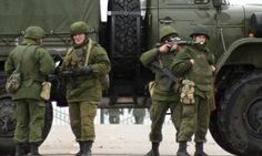 Unidentified soldiers block a road to Ukrainian military airport Belbek not far from Sevastopol.(February 28th, 2014.)
