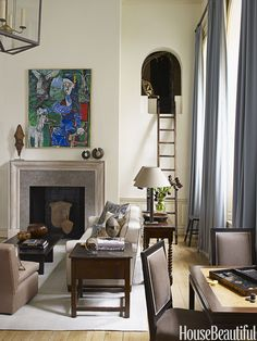 """In a New York City apartment, the ladder leads to a secret room that designer Christopher Maya found, all sealed up, and turned into a """"fantasy room"""" for the children. """"I put lots of books inside it and cushioned seats to sit and read,"""" says Maya. """"But don't you remember how much fun it was to sort of hide and watch your parents' parties? I kind of like to imagine them doing that up there, too.""""   - HouseBeautiful.com"""
