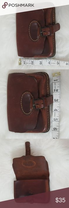 Unisex Vintage real leather cognac belt pouch This is really just an awesome piece. Super thick leather Pouch with two inside slots. Slides onto belt loop. Could be carried comfortably by a man or a woman. No branding or genuine leather markings on inside or outside but can tell by the smell and feel that it is very thick sturdy real leather. Bags Mini Bags