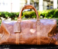 493ead03b28c Buy your December graduate a luxury leather duffle bag from the Texas Tech  Alumni Association!