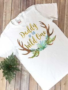 """""""Daddy of the Wild One"""" This design features watercolor style art with the words """"Daddy of the Wild One"""" in a gold """"look"""". The design is printed directly onto t First Birthday Party Themes, Wild One Birthday Party, Baby Girl First Birthday, Third Birthday, Birthday Ideas, First Baby, Birthday Photos, Birthday Gifts, Wild Ones"""