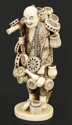 A Chinese Carved Ivory Figure Of A Man.