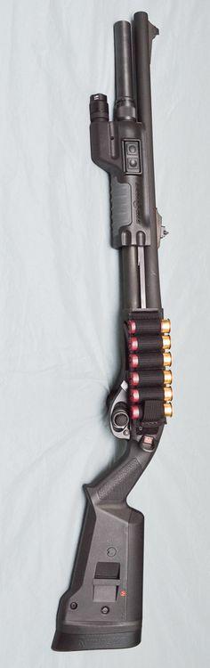 Remington 870 12ga; ext +2 mag tube, surefire forend, Magpul stock, sling mount. hook/loop ammo side saddle.