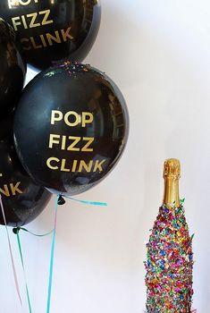 Pop Fizz Clink! Slather glue all over the champagne bottle and roll in confetti!!!