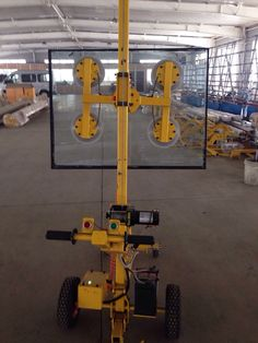 This is a cool automatic glass unloading machine similar to the one my brother wants. It is nice that the buttons are both green and red. The yellow machinery is really stylish too.